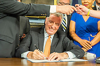 New York Mayor Bill De Blasio, at a bill signing ceremony in the Blue Room in City Hall in New York, on Tuesday, June 28, 2016.  Mayor Bill De Blasio, signed into law a bill, Intro 871-A in relation to insuring equal access to single occupant bathrooms for transgender gender and gender  non-conforming New Yorkers. ( © Frances M. Roberts)