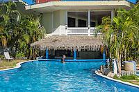 Honduras, Roatan Island, Fantasy Island Resort, Caribbean. Hotel pool ands wim up bar.