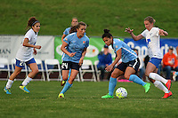 Piscataway, NJ, May 13, 2016. Sky Blue midfielder Raquel Rodriguez (11) slips the ball to teammate Kelly Conheeney (24) as Louise Schillgard (10) of the Boston Breakers defends. Sky Blue FC defeated the Boston Breakers, 1-0, in a National Women's Soccer League (NWSL) match at Yurcak Field.