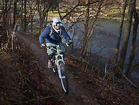 STAFF PHOTO BEN GOFF  @NWABenGoff -- 12/25/14 Audel Garcia rides his mountain bike on the trails at Lake Atalanta park in Rogers on Thursday Dec. 25, 2014. Audel and his son regularly ride at the park.