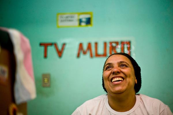 Sabara_MG, Brasil...A TV Muro e uma pequena organizacao produtora de televisao brasileira localizada na cidade de Sabara. E intitulada a menor rede de televisao do mundo. Na foto a esposa do criador da TV Francisco Dario dos Santos, o Chiquinho...The TV Muro is a small Brazilian television network, located in Sabara. Its the smallest TV in the world. Na foto the wife of the creator of tv Francisco Dario dos Santos, Chiquinho...Foto: JOAO MARCOS ROSA / NITRO
