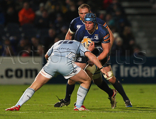 27.10.2012 Dublin, Ireland.Rhys Ruddock prepares himself for a tackle, from Cardiffs Rhys Willimas, during the RaboDirect PRO12 game between Leinster and Cardiff Blues from the Royal Dublin Society.