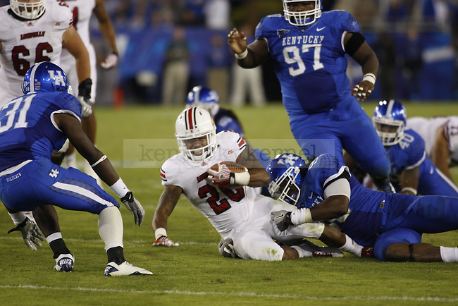 UL running back Victor Anderson gets tackled by UK defenders during the second half of UK's home game against Louisville, Saturday, Sept. 17, 2011 in Lexington, Ky.  Photo by Brandon Goodwin | Staff
