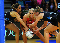 Kayla Cullen (left) and Katrina Grant (right) try to get the ball off Chelsea Pitman during the Taini Jamieson Trophy Series netball match between the New Zealand Silver Ferns and England Roses at Te Rauparaha Arena in Porirua, New Zealand on Wednesday, 7 September 2017. Photo: Dave Lintott / lintottphoto.co.nz