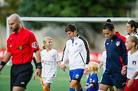 Seattle, Washington -  Sunday, September 11 2016: Seattle Reign FC midfielder Keelin Winters (11) enters the pitch before a regular season National Women's Soccer League (NWSL) match between the Seattle Reign FC and the Washington Spirit at Memorial Stadium. Seattle won 2-0.