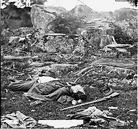 "Gettysburg, Pa. Dead Confederate soldiers in ""the devil's den""].<br /> Photograph from the main eastern theater of the war, Gettysburg, June-July, 1863."