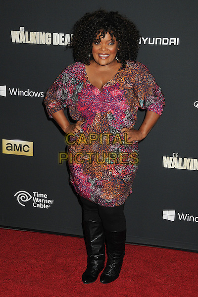 Yvette Nicole Brown<br /> &quot;The Walking Dead&quot; 4th Season Premiere held at the AMC Universal Citywalk Stadium 19 Theatre, Universal City, California, USA, <br /> 3rd October 2013.<br /> full length pink dress hands on hips orange green print black boots <br /> CAP/ADM/BP<br /> &copy;Byron Purvis/AdMedia/Capital Pictures