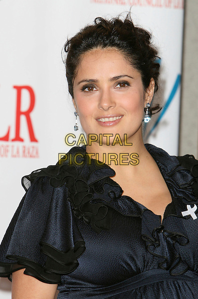 SALMA HAYEK.2007 NCLR ALMA Awards - Press Room held at the Pasadena Civic Center, Pasadena, California, USA..June 1st, 2007.headshot portrait dangling earrings black white ribbon ruffles .CAP/ADM/CH.©Charles Harris/AdMedia/Capital Pictures *** Local Caption *** .