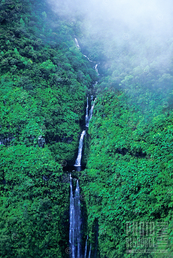 Waterfalls, pools and rainforest at the misty headwaters above the Wailua River. Island of Kauai