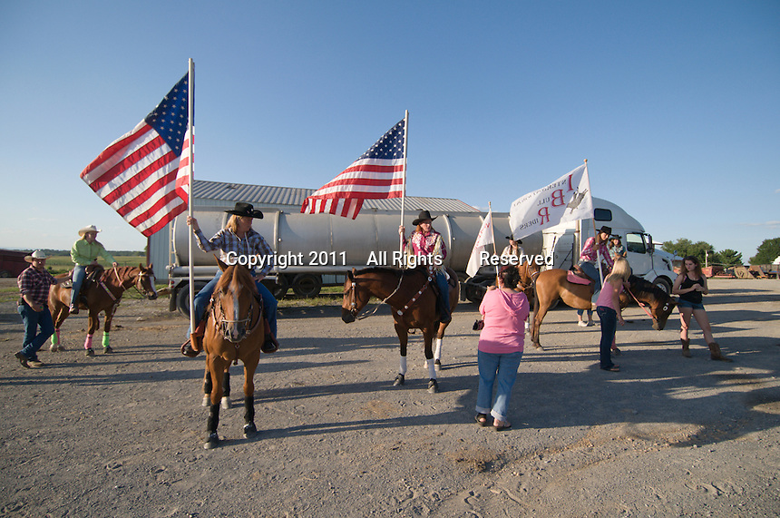 Johnsville, MD: J Bar W Ranch -- Before the start of the rodeo parade, Ann Colson (left) and Amy Albright (right) with American flags.