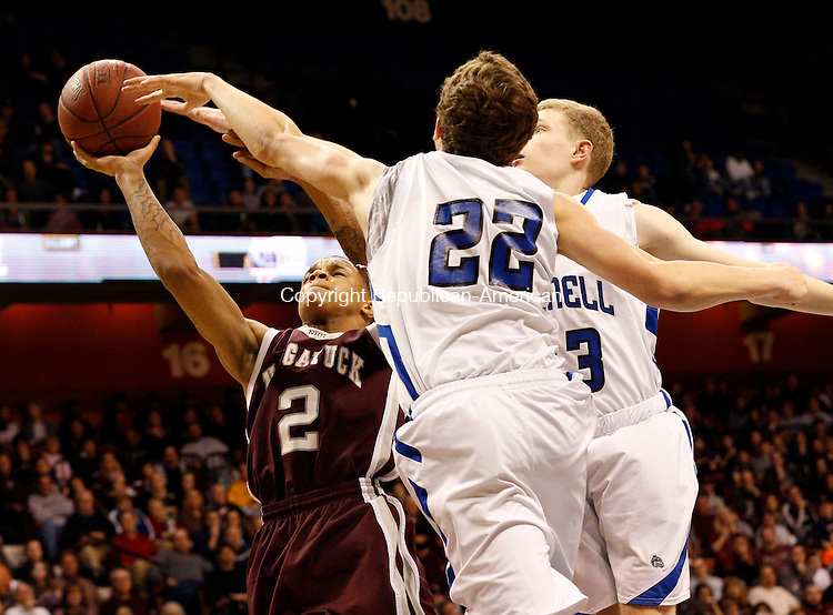 Uncasville, CT- 22 March 2015-032215CM09- Naugatuck's Jarron Chapman (2) goes up against Bunnell's Nicholas Giannoni (22) and Patrick Gough during their first half matchup in the Class L state championship game at Mohegan Sun Arena in Uncasville on Sunday.    Christopher Massa Republican-American
