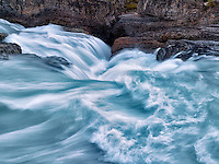 Kicking Horse River and Natural Bridge Falls in British Columbia's Canadian Rockies and Yoho National Park.