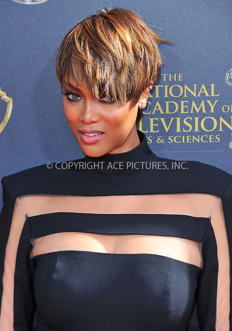 WWW.ACEPIXS.COM<br /> <br /> April 26 2015, LA<br /> <br /> Tyra Banks arriving at The 42nd Annual Daytime Emmy Awards at Warner Bros. Studios on April 26, 2015 in Burbank, California.<br /> <br /> By Line: Peter West/ACE Pictures<br /> <br /> <br /> ACE Pictures, Inc.<br /> tel: 646 769 0430<br /> Email: info@acepixs.com<br /> www.acepixs.com