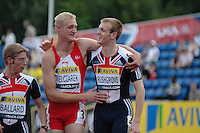 Photo: Tony Oudot/Richard Lane Photography..Aviva London Grand Prix. 25/07/2009. .men's T36- 100m. .Ben Rushgrove of GB is congratulated by Marcin Mielczarek of Poland after winning.