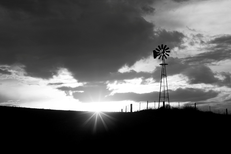 Windmill and thunderstrom at sunset. The Palouse, Washington.