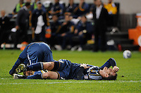 Adam Cristman (17) and Chad Barrett (11) of the Los Angeles Galaxy lay on the turf after a collision. The New York Red Bulls defeated the Los Angeles Galaxy 2-0 during a Major League Soccer (MLS) match at Red Bull Arena in Harrison, NJ, on October 4, 2011.