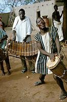 Musicians of Bobo tribe playing drums and balafon xylophone in Koumbia, Burkina Faso, Africa..