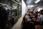 Supporters in the social club at the UTS Stadium with photographs of former player Paul Gascoigne adorning the walls, pictured before the FA Cup fourth qualifying round match between Dunston UTS and their local rivals Gateshead. Founded in 1975, the home team were formerly known as Dunston Federation. The visitors won 4-0 watched by a record crowd of 2,500.