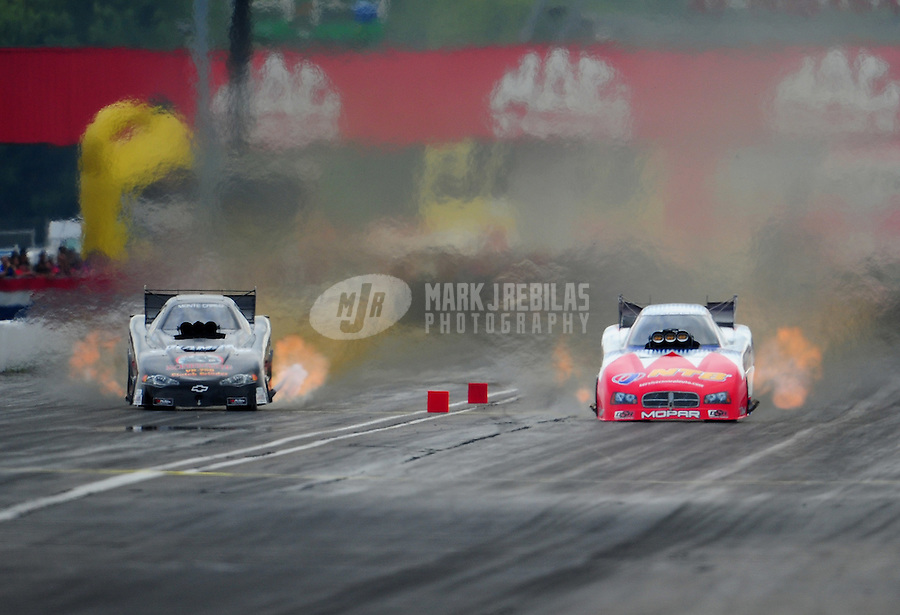 Sept. 4, 2011; Claremont, IN, USA: NHRA funny car driver Johnny Gray (right) races alongside Jon Capps during qualifying for the US Nationals at Lucas Oil Raceway. Mandatory Credit: Mark J. Rebilas-