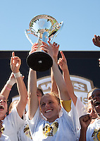 Rachel Buehler holds up the WPS 2010 Championship Trophy. FC Gold Pride defeated the Philadelphia Independence 4-0 to win the 2010 WPS Championship at Pioneer Stadium in Hayward, California on September 26th, 2010.