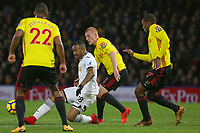 Jordan Ayew of Swansea City (2nd L) manages to pass the ball past three Watford players during the Premier League match between Watford and Swansea City at the Vicarage Road, Watford, England, UK. Saturday 30 December 2017