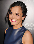 WESTWOOD, CA- AUGUST 07: Actress Alice Braga arrives at the Los Angeles premiere of 'Elysium' at Regency Village Theatre on August 7, 2013 in Westwood, California.