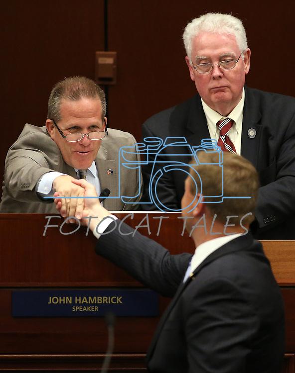 Nevada Lt. Gov. Mark Hutchison, left rear, and Assembly Speaker John Hambrick, R-Las Vegas, right rear, thank U.S. Sen. Dean Heller for his address at the Legislative Building in Carson City, Nev., on Monday, April 6, 2015. <br /> Photo by Cathleen Allison