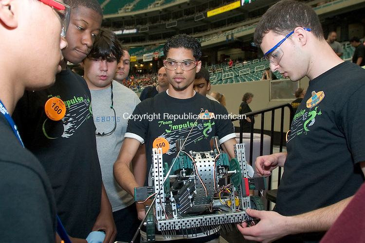 ATLANTA, GA- 28 APRIL 2006- 042806JT19-<br /> Kennedy High's robotics team prepares for their first match of the semifinals at Atlanta's Georgia Dome for the 2006 FIRST Vex Championship Friday. <br /> Josalee Thrift Republican-American