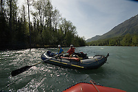 Ed Bennett, left, and Georgia Bennett float down the upper Kenai River on a sunny afternoon.