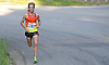 Parker Stinson, 23, of Eugene, OR (Bib No. 2) sets the pace during Northport's annual Cow Harbor 10-kilometer run on Saturday, September 19, 2015. He went on to win the race with a time of 29:11.82.<br /> <br /> James Escher