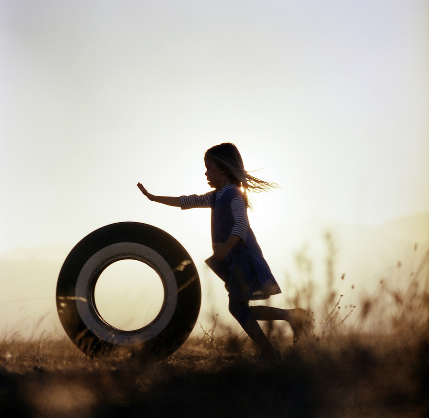 Girl Pushing Tire