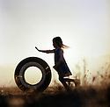 Girl Pushing Tire