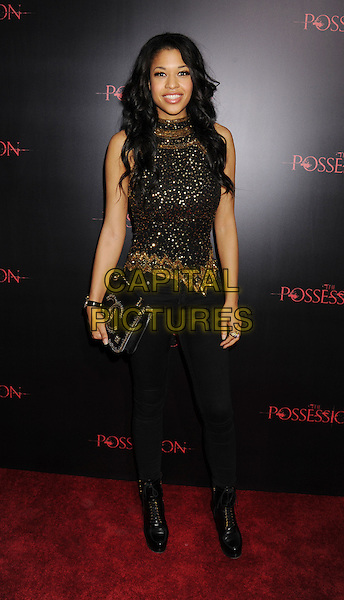 "Kali Hawk.""The Possession"" Los Angeles Premiere held at Arclight Cinemas, Hollywood, California, USA..August 28th, 2012.full length black gold sleeveless sequins sequined top jeans denim boots clutch bag .CAP/ROT/TM.©Tony Michaels/Roth Stock/Capital Pictures"
