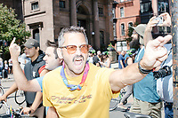 "A man shouts ""Shame"" and ""Hater"" as counterprotesters hold signs toward, flip-off, and angrily shout at those marching in the Straight Pride Parade in Boston, Massachusetts, on Sat., August 31, 2019. The parade was organized in reaction to LGBTQ Pride month activities by an organization called Super Happy Fun America."