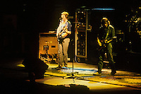 Phil Lesh singing and Bob Weir strumming. The Grateful Dead in Concert at the Brendan Bryne Arena, East Rutherford NJ, on March 30th 1988. View front of stage at level from stage left arena.
