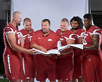 NWA Democrat-Gazette/BEN GOFF &bull; @NWABENGOFF<br /> Coach Bret Bielema and the inside offensive line pose for a photo on Sunday Aug. 9, 2015 during Arkansas football media day at the Fred W. Smith Football Center in Fayetteville.