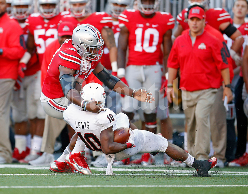 Ohio State Buckeyes linebacker Joshua Perry (37) tackles Northern Illinois Huskies wide receiver Tommylee Lewis (10) after a catch in the 3rd quarter of their game at Ohio Stadium on September 19, 2015.  (Dispatch photo by Kyle Robertson)