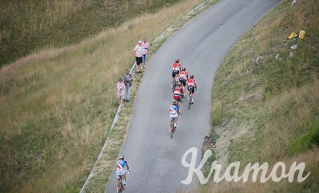 Tony Gallopin (FRA/Lotto-Soudal) escorted up the Col d'Allos (1C/2250m/14km/5.5%) by his teammates Adam Hansen (AUS/Lotto-Soudal) & Thomas De Gendt (BEL/Lotto-Soudal)<br /> <br /> stage 17: Digne-les-Bains - Pra Loup (161km)<br /> 2015 Tour de France