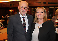 NWA Democrat-Gazette/CARIN SCHOPPMEYER UA Chancellor Joe Steinmetz and wife Sandy greet guests at the UA Women's Giving Circle reception Oct. 31.