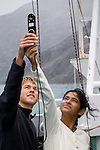 Nicholas and Shruti collect data on the atmospheric luminosity as part of their studies. Cape Farewell Youth Expedition 08(©Robert vanWaarden ALL RIGHTS RESERVED)