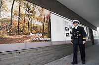 """Auf dem Gelaende des Einsatzfuehrungskommando der Bundeswehr, der Henning-von-Tresckow-Kaserne bei Potsdam, wurde ein Ehrenhain zum Gedenken an die im Einsatz verstorbenen Bundeswehrangehoerigen eingerichtet. In diesem """"Wald der Erinnerunge"""" sind die Gedenkhaine aus den Einsatzgebieten der Bundeswehr errichtet worden. Zum Teil originalgetreu nachgebildet von den Orten in denen die Bundeswehr eingesetzt war und Angehoerige verstorben sind.<br /> Im Bild: Kapitaenleutnat Miller im Informationsgebaeude des Ehrenhain.<br /> 14.11.2014, Potsdam<br /> Copyright: Christian-Ditsch.de<br /> [Inhaltsveraendernde Manipulation des Fotos nur nach ausdruecklicher Genehmigung des Fotografen. Vereinbarungen ueber Abtretung von Persoenlichkeitsrechten/Model Release der abgebildeten Person/Personen liegen nicht vor. NO MODEL RELEASE! Don't publish without copyright Christian-Ditsch.de, Veroeffentlichung nur mit Fotografennennung, sowie gegen Honorar, MwSt. und Beleg. Konto: I N G - D i B a, IBAN DE58500105175400192269, BIC INGDDEFFXXX, Kontakt: post@christian-ditsch.de<br /> Urhebervermerk wird gemaess Paragraph 13 UHG verlangt.]"""