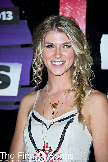 Clara Henningsen of The Henningsens arrives at the 2013 CMT Music Awards at Bridgestone Arena in Nashville, Tennessee.