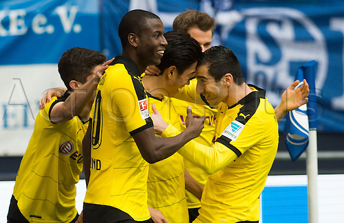 10.04.2016. Gelsenkirchen, Germany.  Dortmund's Shinji Kagawa (C) celebrates his 1-0 goal with team mates Christian Pulisic (L-R), Adrian Ramos and Henrikh Mkhitaryan during the German Bundesliga  match between FCSchalke 04 and Borussia Dortmund at the Veltins Arena in Gelsenkirchen, Germany, 10 April 2016.