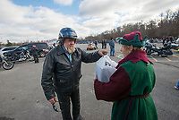NWA Democrat-Gazette/J.T. WAMPLER Henry Hillebrand of Springdale (LEFT) drops off some toys to Tina Redman of Fayetteville Sunday Dec. 2, 2018 during the 5th Annual NWA Bikers Toy Run. More than 200 motorcyclists paraded from the north side of Fayetteville to Greenland. The event was open to all Northwest Arkansas motorcycle clubs.