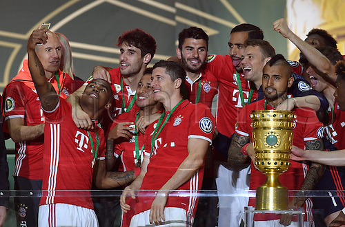21.05.2016. Berlin, Germany.  Munich players take a selfie with the DFB Cup trophy prior to receiving it after the German DFB Cup final  match between Bayern Munich and Borussia Dortmund at the Olympic Stadium in Berlin,Germany, 21 May 2016.  After a 0-0 end to play, Bayern went on to win the penalty shoot-out by a score of 4-3.