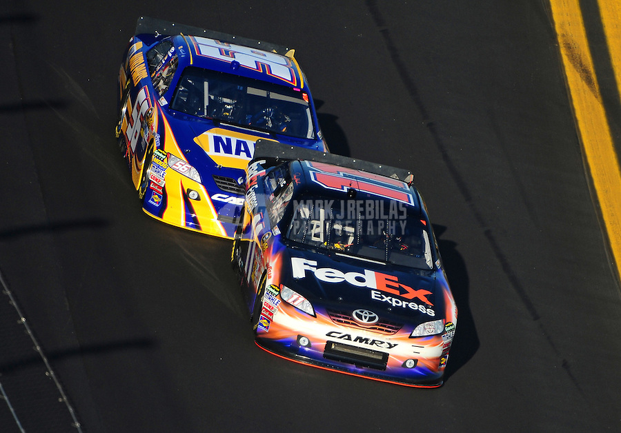 Feb 17, 2011; Daytona Beach, FL, USA; NASCAR Sprint Cup Series driver Denny Hamlin leads Martin Truex Jr during race two of the Gatorade Duel at Daytona International Speedway. Mandatory Credit: Mark J. Rebilas-