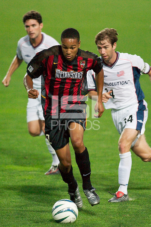 Ricardo Clark of the MetroStars being chased by Jay Heaps and Steve Ralston of the Revolution. The New England Revolution were defeated by the NY/NJ MetroStars 2-1 during quarterfinals action of the Lamar Hunt U.S. Open Cup on 8/27/03 at Yurcak Field, Rutgers University, Piscataway, NJ..