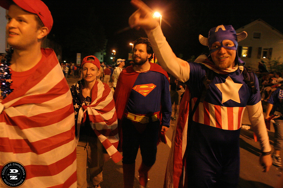 USA National Soccer Team fan  Greg Nelson of Oakland, CA, dressed up as Captian America,  points to some other fans cheering outside the stadium after the USA's FIFA World Cup First round match against Italy on Saturday June 17th, 2006 in Kaiserslautern, Germany.  The USA and Italy tied 1-1.