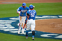 21 March 2009: #15 Yong-Kyu Lee of Korea celebrates with #52 Tae Kyun Kim after scoring on a single by #50 Hyun-Soo Kim during the 2009 World Baseball Classic semifinal game at Dodger Stadium in Los Angeles, California, USA. Korea wins 10-2 over Venezuela.