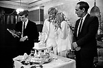 Best man speech. Father of bride on right. Caxton Hall Westminster London. London's main register office until 1979. White wedding his and her uni sex clothes trouser suits flares or bell bottoms and cuban healed shoes. Long hair. 1970s fashionable London ..<br /> He is Michael Stephens I think a well know hairdresser of the time. If you know otherwise please let me know.